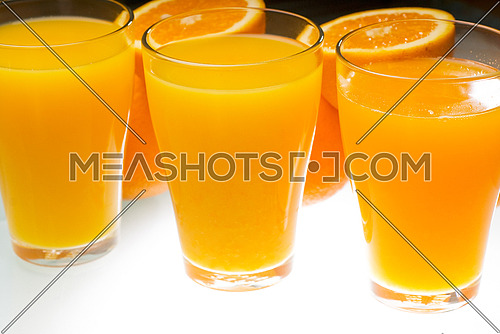 fresh and healthy orange juice ,unfiltered ,over a light table