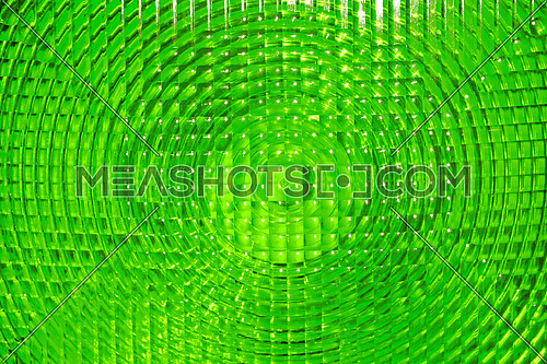 Abstract background of vivid green faceted plastic reflective surface sign
