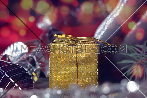 Festive Christmas background with golden gift and assorted decorations