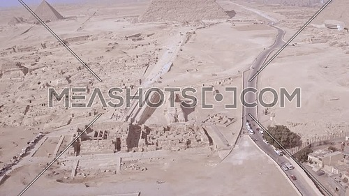 Fly over shot drom for the city of Giza Showing the three pyramids then go down for The sphinx face in Giza at Day