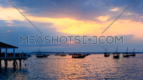Typical boats docked in the port of  Stone Town ,Zanzibar, Tanzania republic, at sunset.