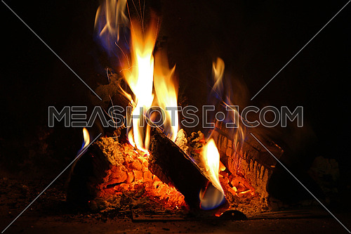 Yellow flames from campfire