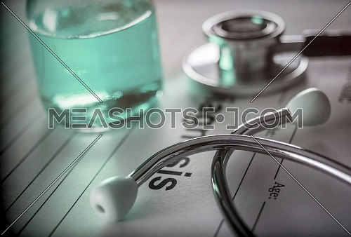 Vial of medication along with a stethoscope, conceptual image