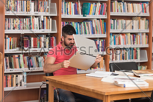 Arabic Male College Student Stressed About His Homework