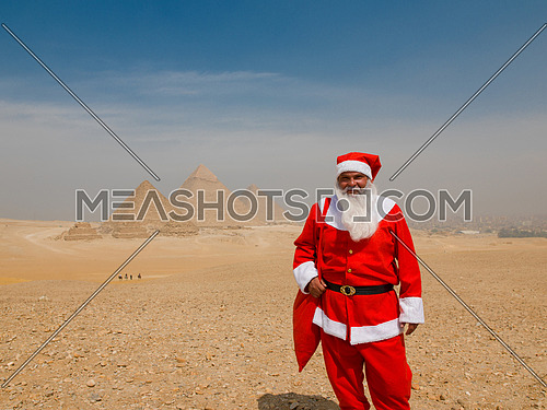santa claus in egyptian pyramids desert