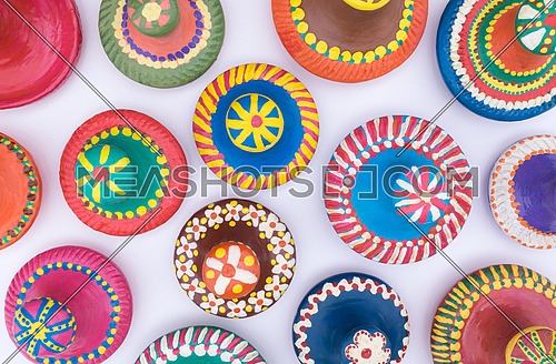 Composition of colorful painted pottery lids
