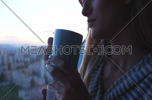 Romantic Couple At Sunset drinking coffee