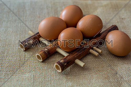 Chicken eggs on bamboo pad as back ground