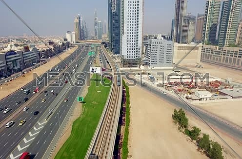 Arial shot for Al Shaikh Zayed Road Using Drone following the train in Dubai At Day