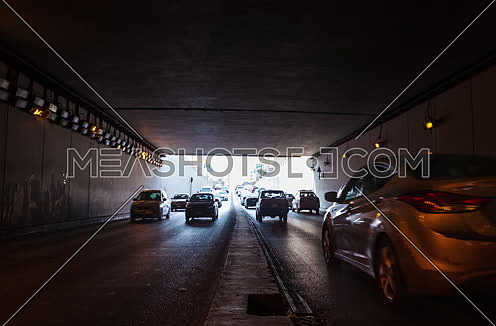 Zoom OUT Shot for traffic from inside  Al Thawra Tunnel at Daytime