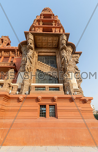 Low angle of the tower of Baron Empain Palace, a historic mansion inspired by the Cambodian Hindu temple of Angkor Wat, located in Heliopolis district, Cairo, Egypt
