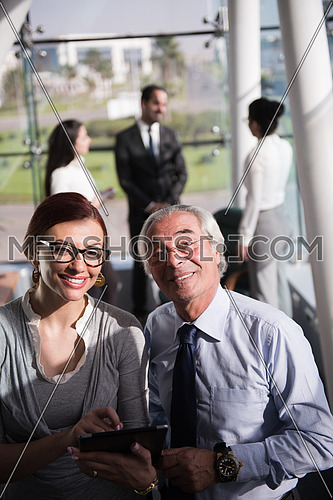 group of executives having a  meeting in a bright office