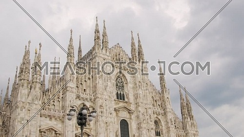 """""""Nice view of Duomo with the golden statue name """"""""Madonnina"""""""" on the top of the main spire,overcast sky."""""""