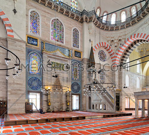 Istanbul, Turkey - April 19, 2017: Marble floral golden ornate minbar (Platform) and niche , Suleymaniye Mosque, Istanbul, Turkey