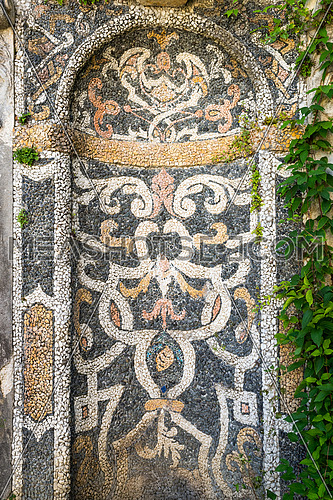 In the picture a wonderful mosaic located inside the gardens of \