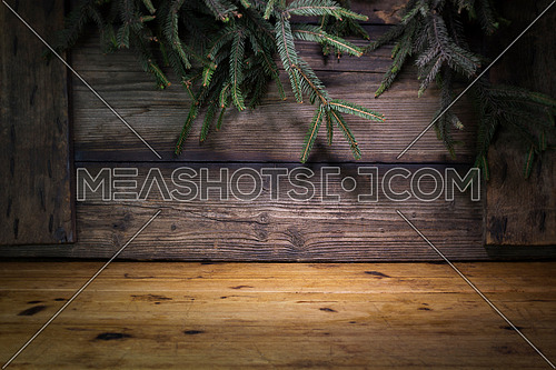 Christmas Background With Pine Branches and Wood logs On a Rustic Wooden Boards