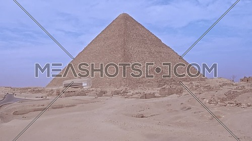 Reavel shot for The Great Pyramid of Khufu in background in Giza at day