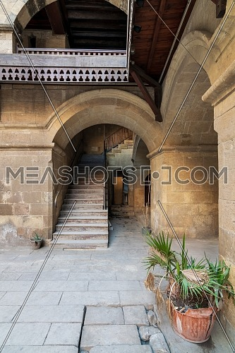 Exterior daylight shot of staircase going up leading to Wikalet Bazaraa historic public Caravansary building, suited in Gamalia district, Medieval Cairo, Egypt
