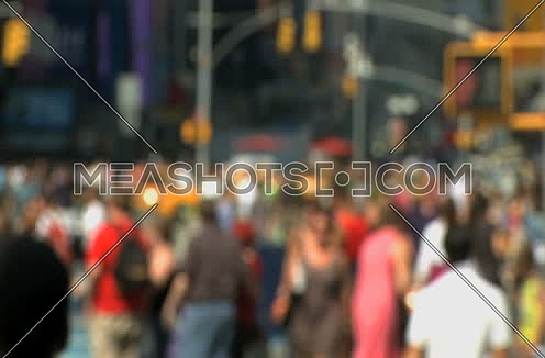blurred pedestrians walking in New York city