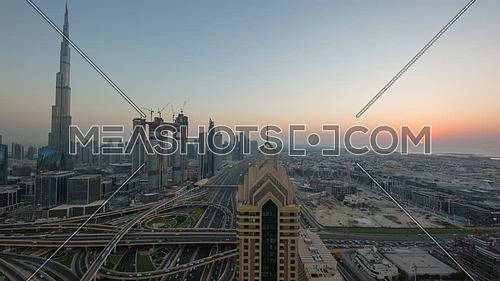 Long shot for Dubai City showing Burj khalifa in background and Roads from day to sunset.
