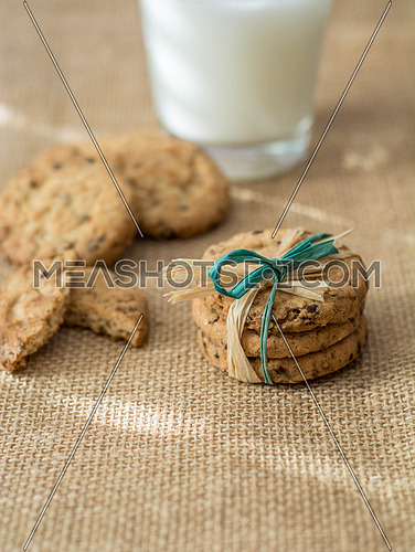Homemade cookies,cinnamon and milk on textile backgraound