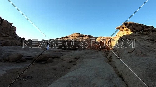 Long shot for bedouin man climbing Sinai/moses  Mountain at sunset.