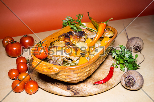 Grilled chicken legs with potatoes and vegetables