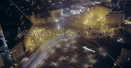 Fly out Drone shot for Tahrir Square showing National Flag Pole in Cairo at night
