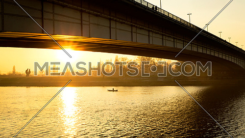 Sunset underneath the bridge reflecting out of water