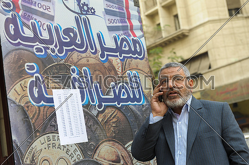 Egyptian citizen inquires about exchange rates in front of one of the exchange shops in Cairo on 31 December 2012