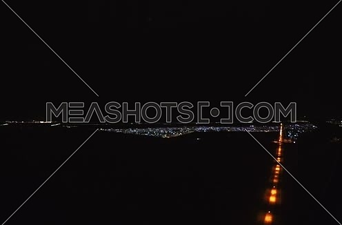 from inisde shot form plane window while flying at Night