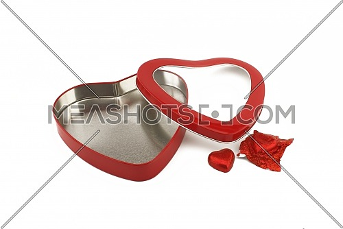 Red heart shaped box with chocolate candy on a white background with copy space symbolic of love and romance for Valentines