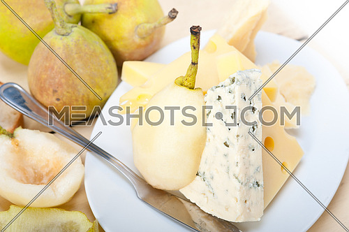 selection of cheese and fresh pears appetizer snack
