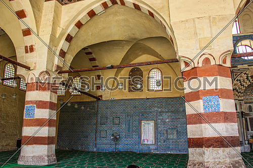 a photo from the blue mosque in old Fatimid Cairo (sonkor ) showing the architecture style and blue color used and the prayers direction , Egypt