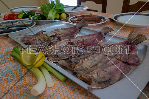 Egyptian Traditional Sham El Nesim salted mullet with spring onions and lemon