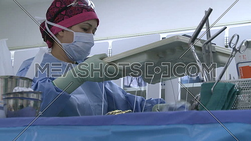 medium shot for nurse working during surgery