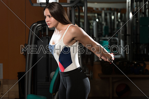 Young Woman Stretches In Fitness Club