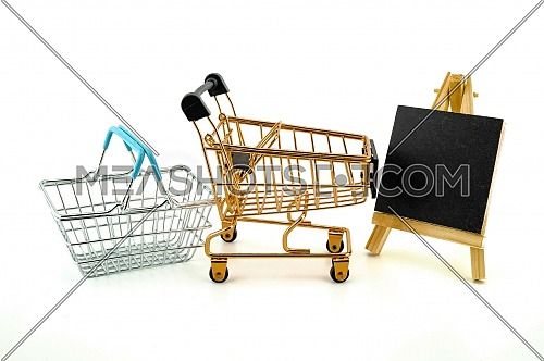 Shopping concept with shopping cart, basket and small chalk board isolated on white background
