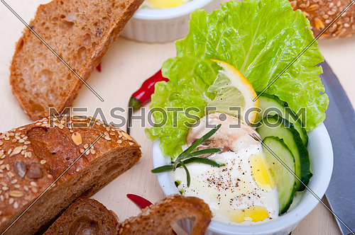 fresh organic garlic cheese dip salad on a rustic table with bread