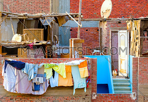 a poor Local District where people are hanging their clothes out in the balcony