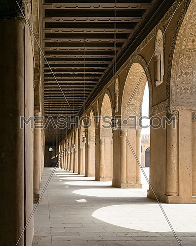 One of the passages surrounding  the courtyard of the Mosque of Ahmad Ibn Tulun, the largest mosque in Cairo, Egypt. and may be the oldest mosque in the city with its original form. The mosque was commissioned by Ahmad Ibn Tulun, the Abbassid governor of Egypt from 868–884.  The mosque was constructed on a small hill called Gebel Yashkur (English: The Hill of Thanksgiving)