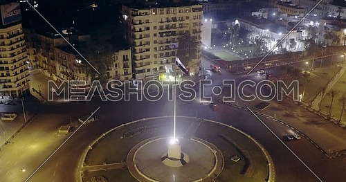 Drone shot fly towards Tahrir Square showing National Flag Pole in Cairo at night