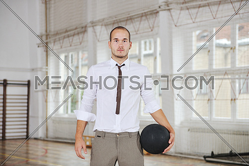 young business man basket player hold basketball ball and representing success and retirement in sport like also sports management concept