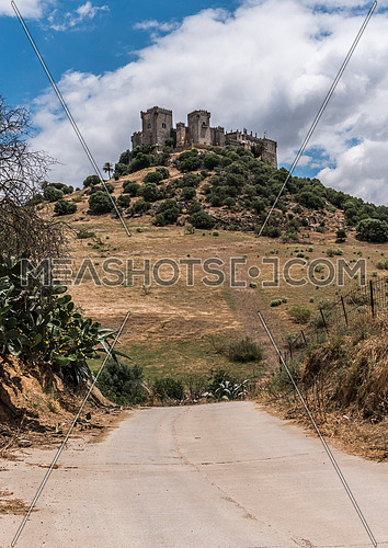 Almodovar del Rio, Cordoba, Spain - June 9, 2018: It is a fortitude of Moslem origin, it was a Roman fort and the current building has definitely origin Berber, of the year 760, Between the year 1901 and 1936 was restored by its owner, Rafael Desmaissieres y Farina, XII Count of Torralva, placed close to the Guadalquivir, take in Almodovar of the Rio, Cordoba province, Andalusia, Spain
