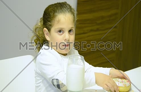 close up for little girl drinking milk