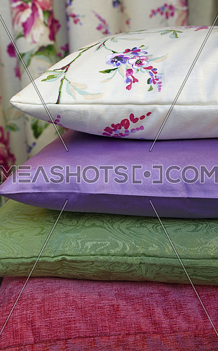 Selection of colorful pillows in retail store, close up, low angle view