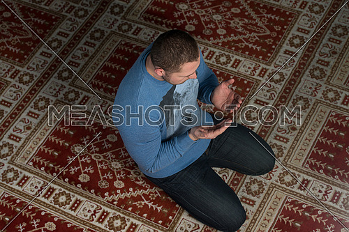 Muslim Men Is Praying In The Mosque