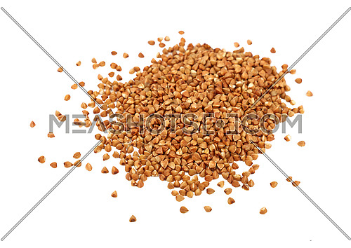 Close up heap of dried brown buckwheat (Fagopyrum esculentum) groats isolated on white background, close up, high angle view