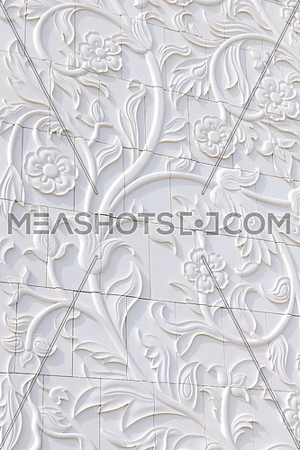 stone background texture with floral design carved in marble
