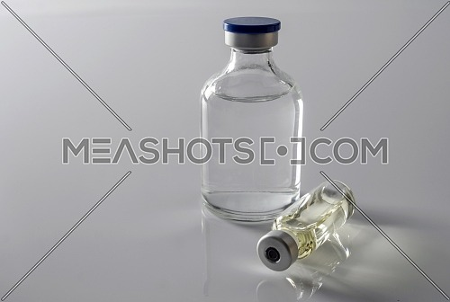 Several vials isolated on white background, conceptual image